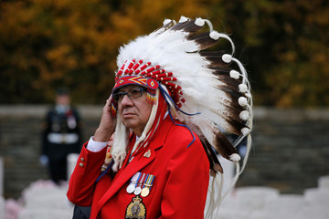 Roy Louis, member of the Samson Cree Nation, and Canadian veterans attend a ceremony at Canadian National Memorial at Vimy cemetery