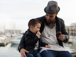 Man with son eating sweets