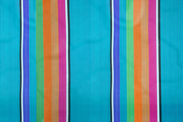 colorful striped fabric background, texture of folding beach chair