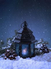 Night Snowy Setting of a Glowing Lantern