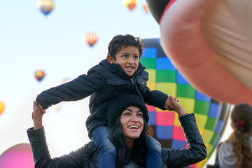 Excited mom and son at a hot air balloon festival