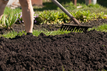 Woman plowing the ground