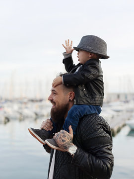 Dad and son walking at seaside