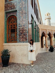Woman standing in front of a mosque in Doha