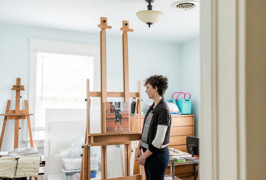Woman looking at her painting