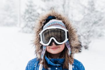 Preteen girl dressed for outdoor winter fun