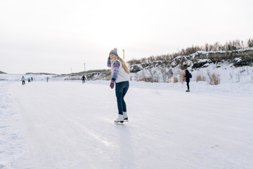 Woman blading on rink
