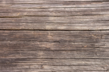 Brown wooden horizontal planks. Aged grunge wooden panels. Organic wall decoration. Hardwood boards. Wooden texture closeup.