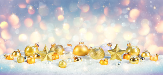 Christmas - Golden Baubles On Snow With Shiny Background