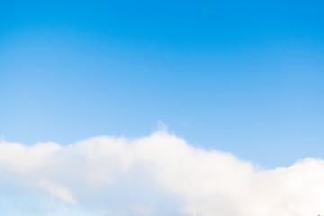 clouds in the bright blue sky