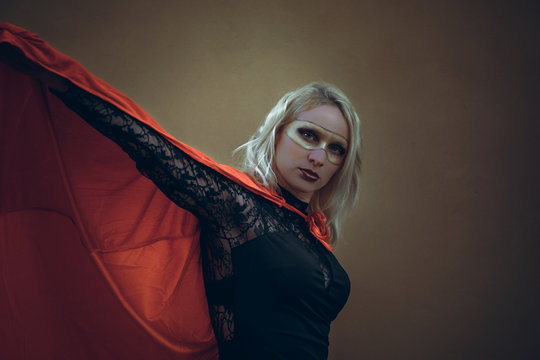 superheroine with red cape