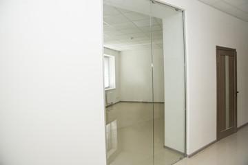 office corridor door glass, with door of light wood