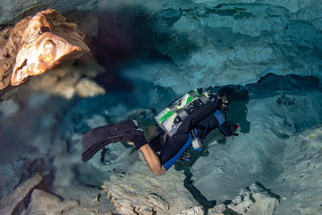 halocline effect while diving in cenotes cave in Mexico Wall mural