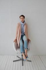 Pretty stylish woman on chair