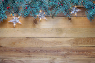 Christmas Fir Tree and garland on wooden background.Copy space