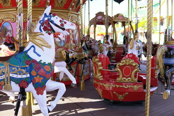 Carousel for children with horses attractions in the Park