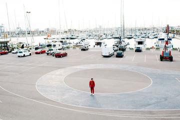 Sportive man on parking lot