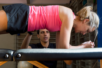 Instructor working with client in gym