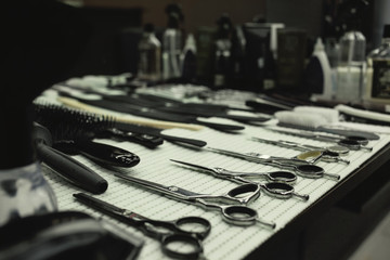 Barber's work table with a set of scissors