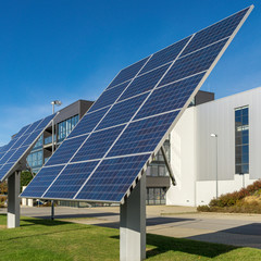 solar panels in front of a factory building