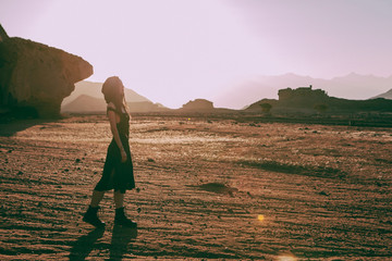 Beautiful young woman in Timna, desert in Israel. Rocks in sunset time. Mystic concept