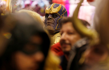 A participant wearing a cosplay costume attends the 5th Hero Festival in Marseille
