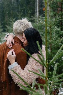 Embracing gentle couple in snowfall