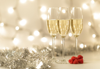 Three glasses of Christmas champagne with bokeh