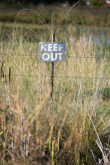 keep out sign on a rural property