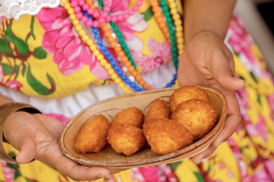 Brazilian food: baiana showing acaraje