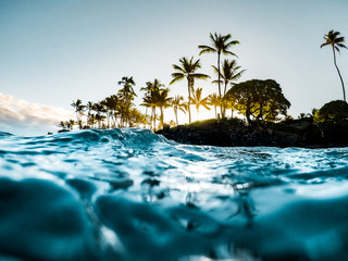 Beautiful Tropical Island Paradise Photo from Swimming In Clear Aqua Blue Ocean Water with Colorful...