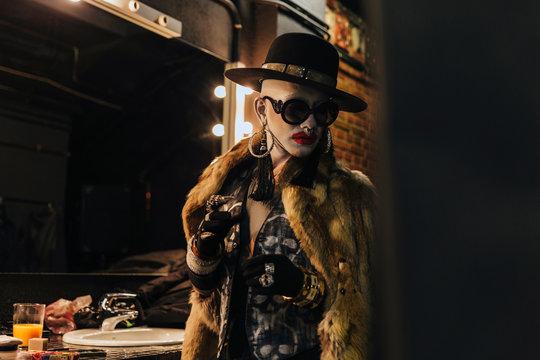 Fashion elegant bizarre man with extreme makeup