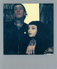 Polaroid scan of an unconventional gothic couple  with silver frame