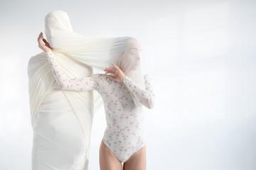 Woman with mummy-like stranger