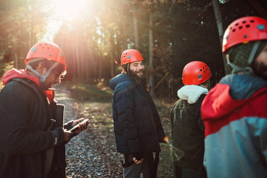 Friends enjoy the outdoors and sunshine during a zip line course in upstate New York