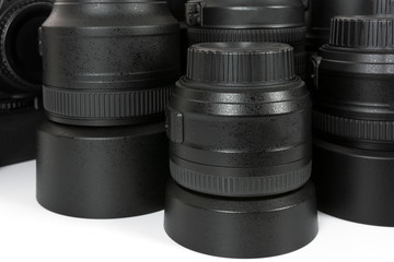 Collection of professional and modern lenses and DSLR camera in close-up.