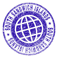 SOUTH SANDWICH ISLANDS stamp imprint with distress effect. Blue vector rubber seal imprint of SOUTH SANDWICH ISLANDS title with grunge texture. Seal has words placed by circle and planet symbol.