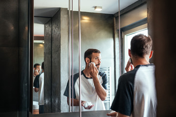 Man Putting Shaving Foam on His Face