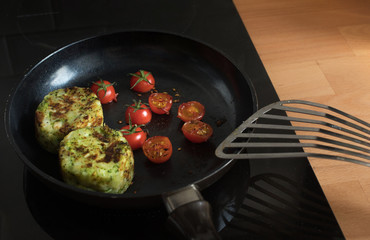 Breakfast cooking with tomato and Potato on pan