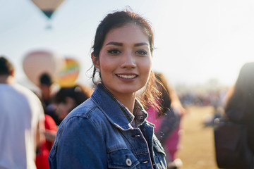 Young attractive woman at balloon festival