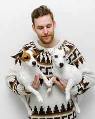 Man holding two dogs