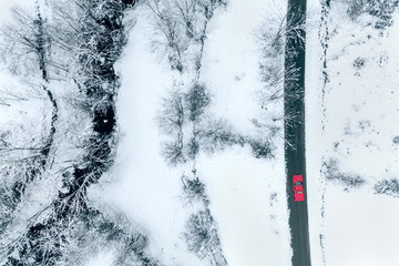 Aerial view of a road through a snowy field