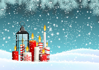 Group of Christmas candles in snowy landscape
