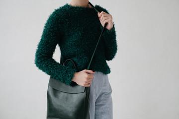 Stylish woman holding bag