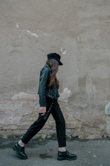 stylish girl in a cap in motion