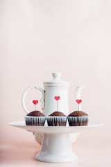 Three cupcakes with red heart Valentine's day ornaments