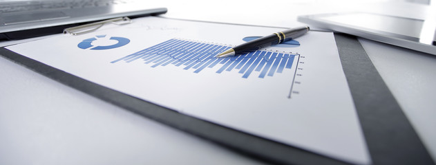 close up. financial chart on the table at the businessman