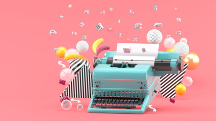 Blue typewriter surrounded by letters and colorful balls on a pink background.-3d render.. Wall mural