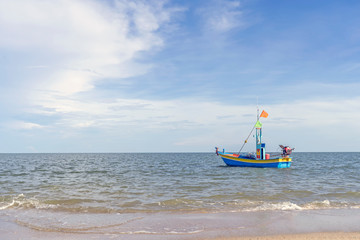 Fishing boat floating in the sea with blue sky