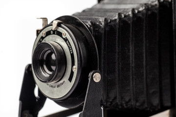 Vintage Folding Camera on white background